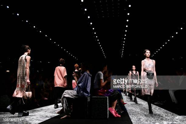 Models present creations for Marco De Vincenzo fashion house during the Women's Spring/Summer 2019 fashion shows in Milan on September 21 2018