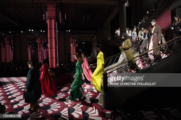 Models present creations for Miu Miu at the end of the Women's Fall-Winter 2020-2021 Ready-to-Wear collection fashion show in Paris, on March 3, 2020.