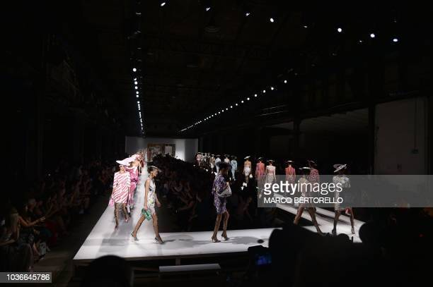 Models present creations for Moschino fashion house during the Women's Spring/Summer 2019 fashion shows in Milan on September 20 2018