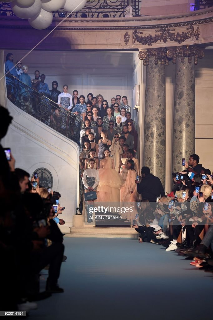 Models present creations for Off-White during the 2018/2019 fall/winter collection fashion show on March 1, 2018 in Paris. /