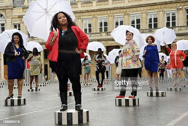 Models present creations for plus-size women by French fashion designer Jean-Marc Philippe on May 16, 2013 at the Palais Royal in Paris. AFP PHOTO /...