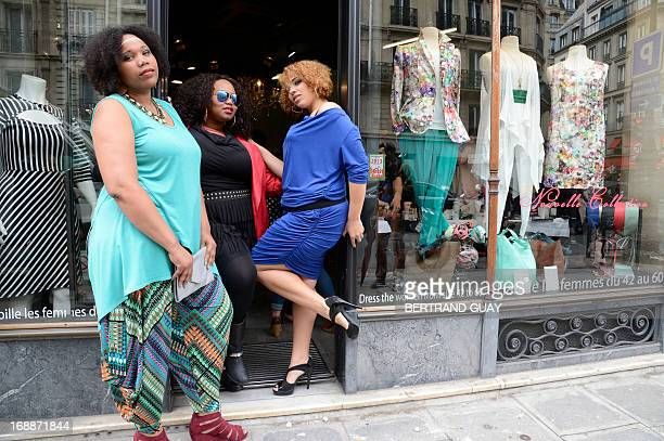 Models present creations for plus-sized women by French fashion designer Jean-Marc Philippe on May 16, 2013 in a street of Paris. AFP PHOTO /...