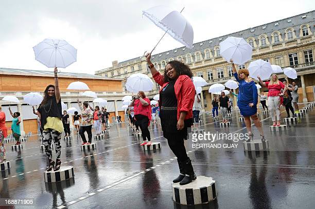 Models present creations for plus-sized women by French fashion designer Jean-Marc Philippe on May 16, 2013 in the Palais Royal in Paris. AFP PHOTO /...