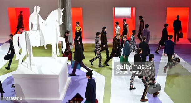 Models present creations for Prada as part of the men's fall/winter 2020/21 fashion collections in Milan on January 12, 2020.