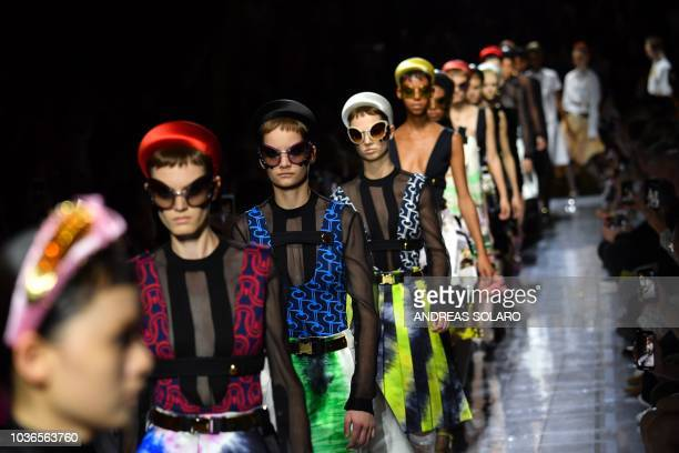 Models present creations for Prada fashion house during the Women's Spring/Summer 2019 fashion shows in Milan on September 20 2018