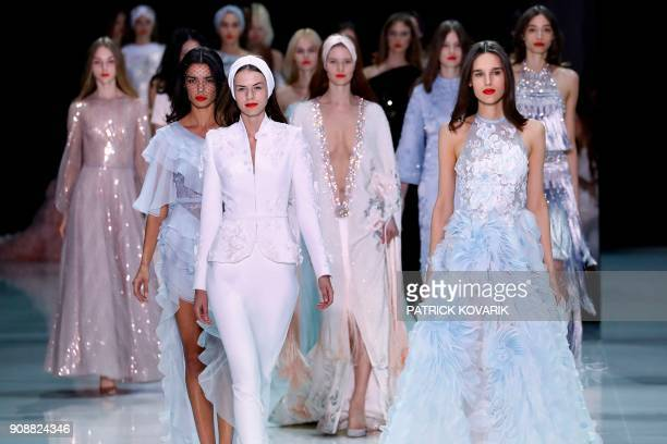 Models present creations for Ralph Russo during the 2018 spring/summer Haute Couture collection fashion show on January 22 2018 in Paris / AFP PHOTO...