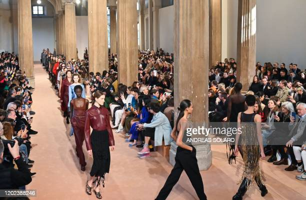 Models present creations for Salvatore Ferragamo's Women Fall Winter 2020 fashion collection on February 22 2020 in Milan