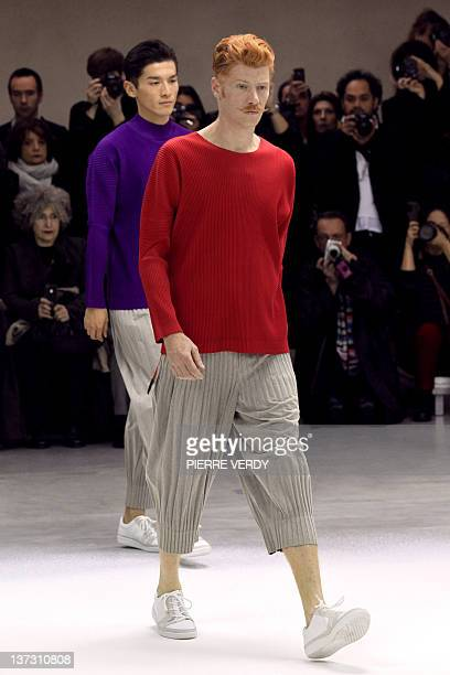 Models present creations for the label Issey Miyake during the Autumn-Winter 2012/2013 men's fashion collection show, on January 19, 2012 in Paris....