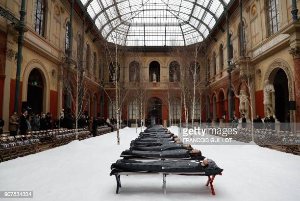 TOPSHOT Models present creations for Thom Browne during the men's Fall/Winter 2018/2019 fashion show in Paris on January 20 2018 / AFP PHOTO /...
