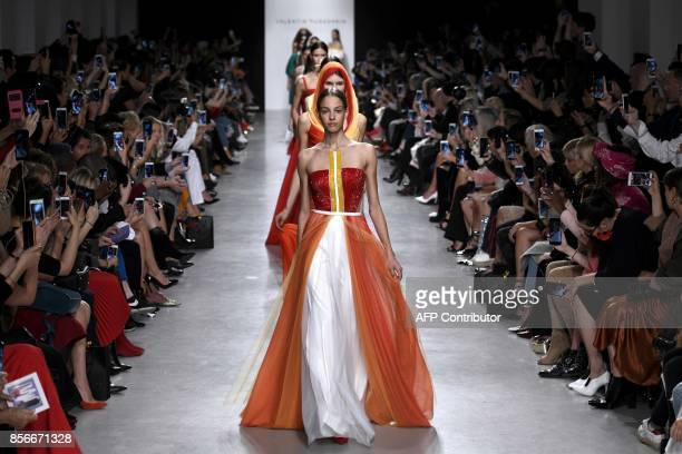 Models present creations for Valentin Yudashkin during the women's 2018 Spring/Summer ready-to-wear collection fashion show in Paris, on October 2,...