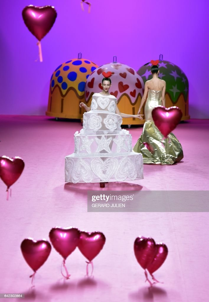 Models present creations from Agatha Ruiz de la Prada's Autumn/Winter 2017-2018 collection during the Mercedes-Benz Madrid Fashion Week in Madrid on February 17, 2017. / AFP / GERARD