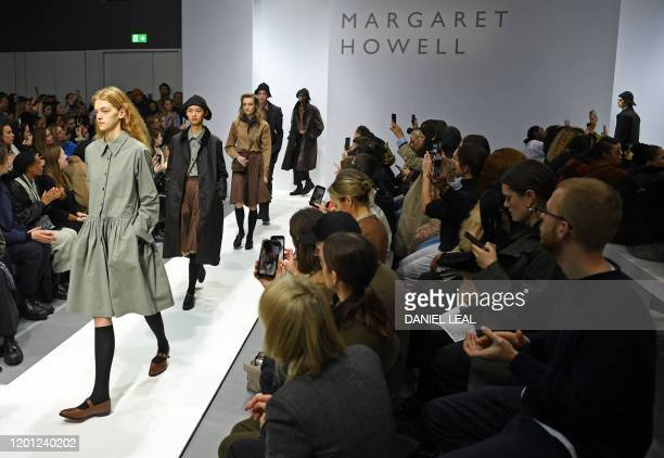Models present creations from British designer Margaret Howell during their 2020 Autumn / Winter collection catwalk show at London Fashion Week in...