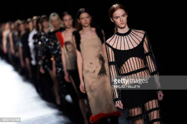 Models present creations from designer Christopher Kane during their catwalk show on the fourth day of London Fashion Week Autumn/Winter 2018 in...