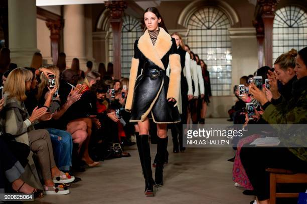 Models present creations from designer David Koma during their catwalk show on the fourth day of London Fashion Week Autumn/Winter 2018 in London on...