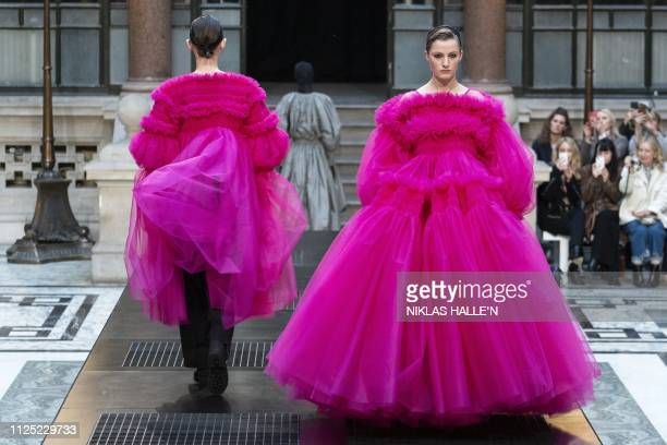TOPSHOT Models present creations from designer Molly Goddard during her 2019 Autumn / Winter collection catwalk show at London Fashion Week at the...