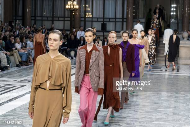 Models present creations from designer Victoria Beckham during a catwalk show for the Spring/Summer 2020 collection on the third day of London...