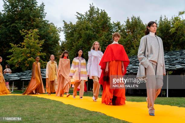 Models present creations from fashion brand Roksanda during a catwalk show for the Spring/Summer 2020 collection on the fourth day of London Fashion...
