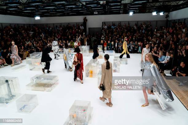 Models present creations from fashion designer JW Anderson during a catwalk show for the Spring/Summer 2020 collection on the fourth day of London...