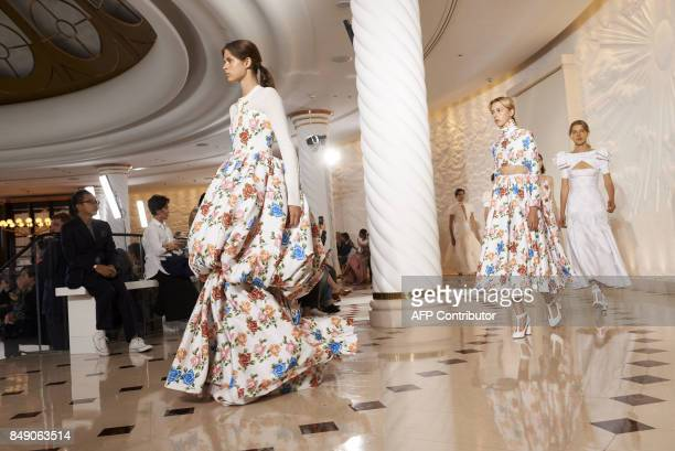 Models present creations from New Zealandborn designer Emilia Wickstead during a catwalk show for the Spring/Summer 2018 collection on the fourth day...
