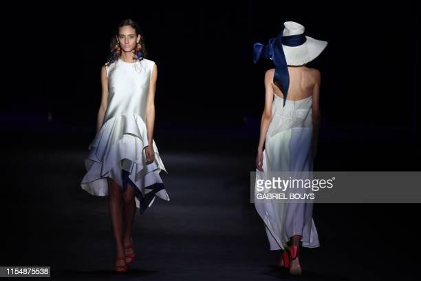 Models present creations from Spanish designer Ulises Merida's Spring/Summer 2020 collection during the Mercedes Benz Fashion Week in Madrid on July...