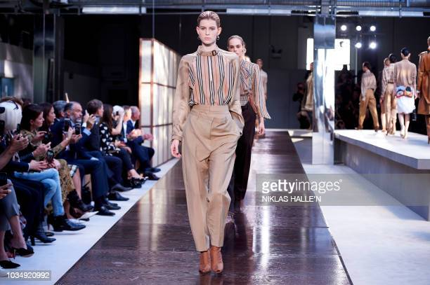 Models present creations from the Burberry collection during a catwalk show for the Spring/Summer 2019 collection on the fourth day of London Fashion...