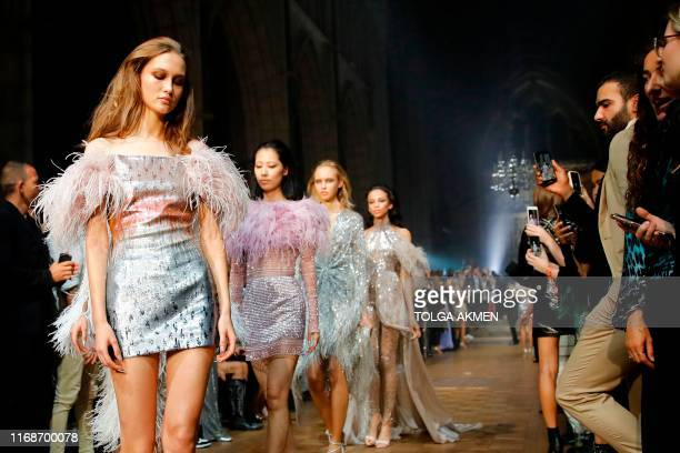 TOPSHOT Models present creations from the 'Julien x Gabriela' collection by Julien Macdonald during a catwalk show for the Spring/Summer 2020...