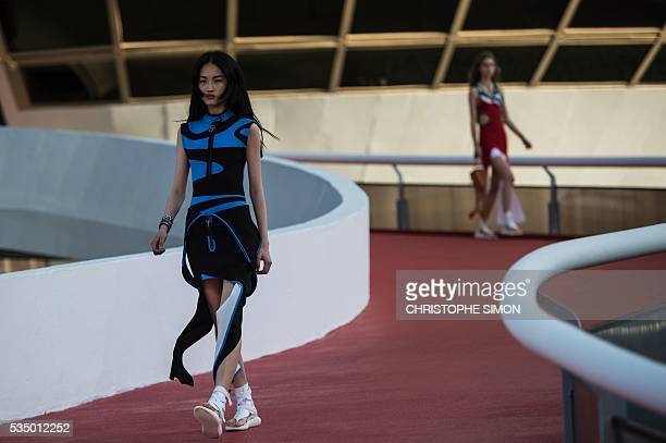 Models present creations from the Louis Vuitton 'Cruise' 2017 collection at the Contemporary Art Museum designed by famed Brazilian architect Oscar...