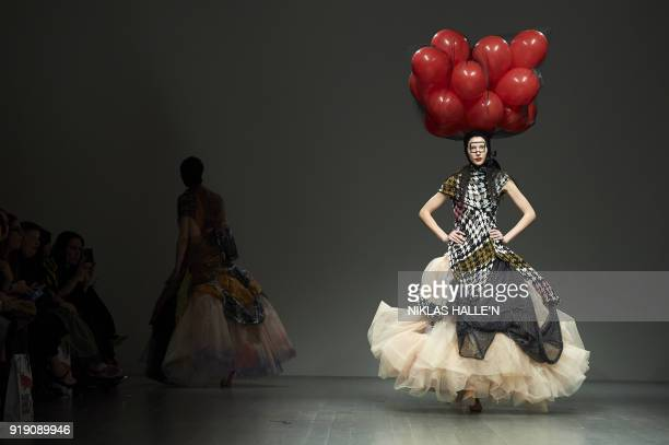 TOPSHOT Models present creations from the Matty Bovan collection during their catwalk show on the first day of London Fashion Week Autumn/Winter 2018...