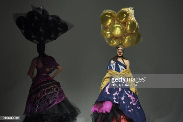 Models present creations from the Matty Bovan collection during their catwalk show on the first day of London Fashion Week Autumn/Winter 2018 in...