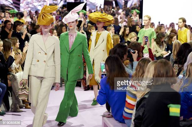 Models present creations from the Mulberry collection during their show on the first day of London Fashion Week Autumn/Winter 2018 in London on...