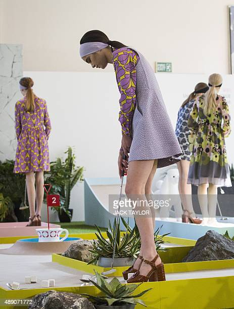 Models present creations from the Orla Kiely collection during a crazygolfthemed show during the 2016 Spring / Summer London Fashion Week in London...