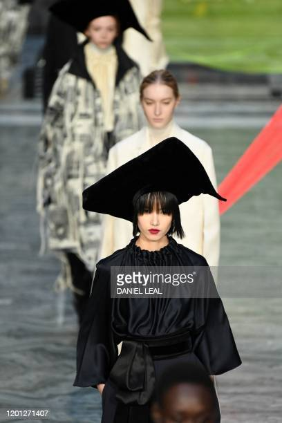 Models present creations from the Roksanda collection during their 2020 Autumn / Winter collection catwalk show at the Foreign and Commonwealth...