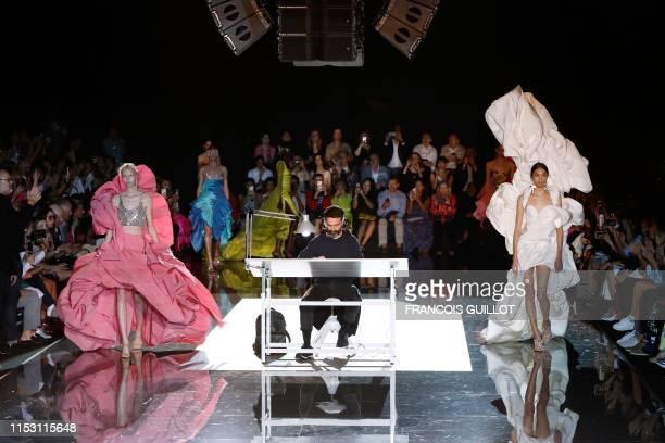 TOPSHOT Models present creations next to fashion designer for Schiaparelli Daniel Roseberry during the Women's FallWinter 2019/2020 Haute Couture...