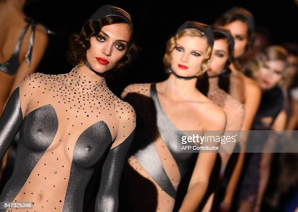TOPSHOT Models present creations of Andres Sarda's Spring/Summer 2018 collection during the Madrid Fashion Week in Madrid on September 15 2017 / AFP...