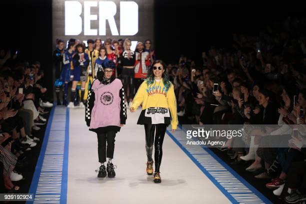 Models present creations of designer Deniz Berdan during the MercedesBenz Fashion Week / Fall Season 2018 at the Zorlu Performing Arts Center in...