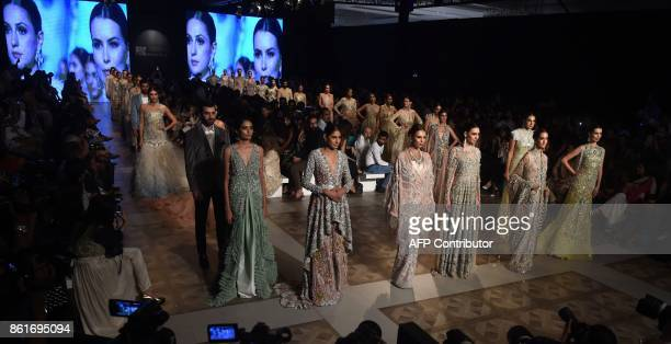 Models present creations of designer Sana Safinaz during the second day of the Pakistan Fashion Design Council LOreal Paris Bridal Week in Lahore on...