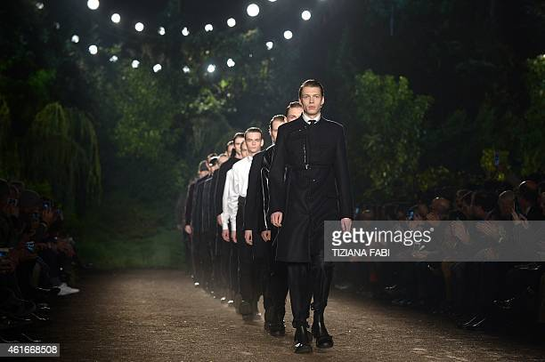 Models present creations part of the Ermenegildo Zegna collection show during the Fall/Winter 2015 Men's Fashion Week on January 17, 2015 in Milan....
