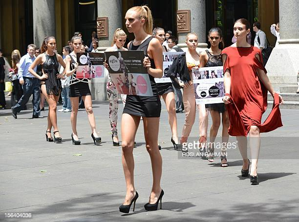 Models present designs by students for the Australian Graduates Fashion Week to promote its upcoming event in downtown Sydney on November 15 2012 A...