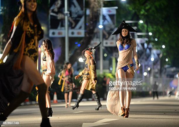 Models present fashion creations for retail outlets on the street during the Orchard Fashion Runway 2014 in Singapore on April 5 2014 More than 100...