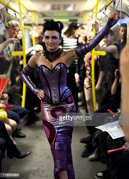 """Models present fashion during the """"Underground Catwalk"""" show during the Berlin Fashion Week on July 6, 2011. The fashion show took place in a driving..."""