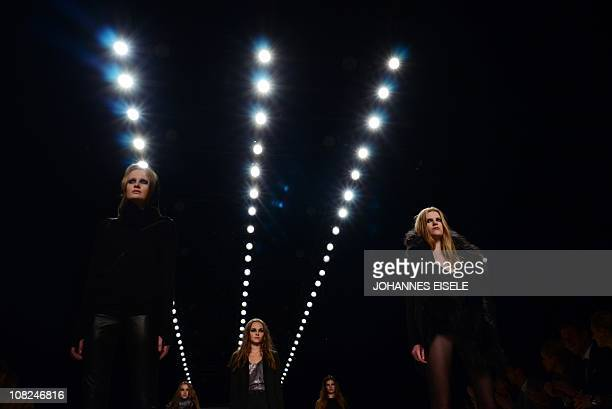 Models present fashion of Danish designer label Bllack Noir during the Berlin fashion week in Berlin on January 22 2011 The Berlin Fashion Week is...