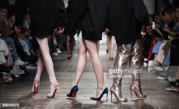 Models present fashion of the label 'Marina Hoermanseder' during the Fashion Week in Berlin on January 18 2018 / AFP PHOTO / dpa / Jens Kalaene /...