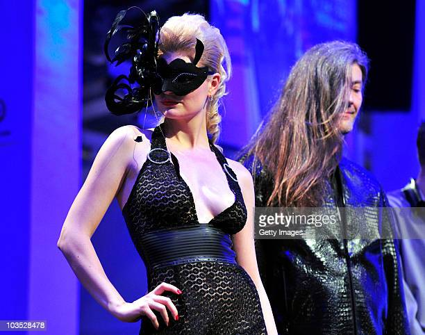 AUGUST 21 Models present latest chicque in rubber fashion of label bodycult during a fashion show at the Latexpo 2010 at the Edelfettwerk on August...