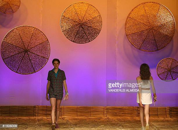 Models present outfits by designer Teca during the Rio Fashion Week SpringSummer 200809 collection at the Marina da Gloria on June 9 2008 in Rio de...