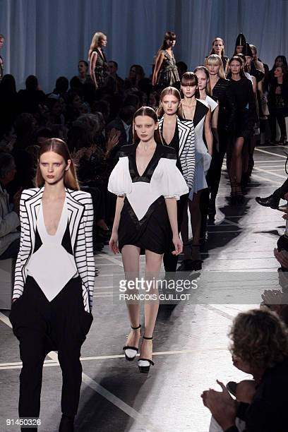 Models present outfits by Italian designer Riccardo Tisci for Givenchy during readytowear SpringSummer 2010 fashion show on October 4 2009 in Paris...