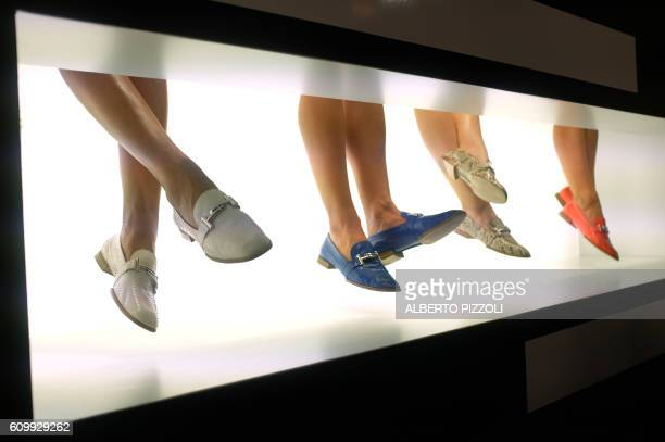 Models present shoes for fashion house Tod's during the 2017 Women's Spring / Summer collections shows at Milan Fashion Week on September 23, 2016 in...