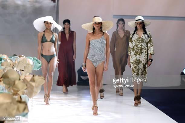 Models present swimwear creations at the International Exhibition of Lingerie 'Salon De La Lingerie' Summer Collection at Parc des Expositions Porte...