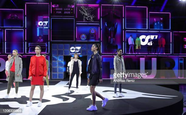 Models present the AlphaTauri`s key Spring Summer 2020 looks during the Scuderia Alpha Tauri launch event at Hangar 7 on February 14 2020 in Salzburg...
