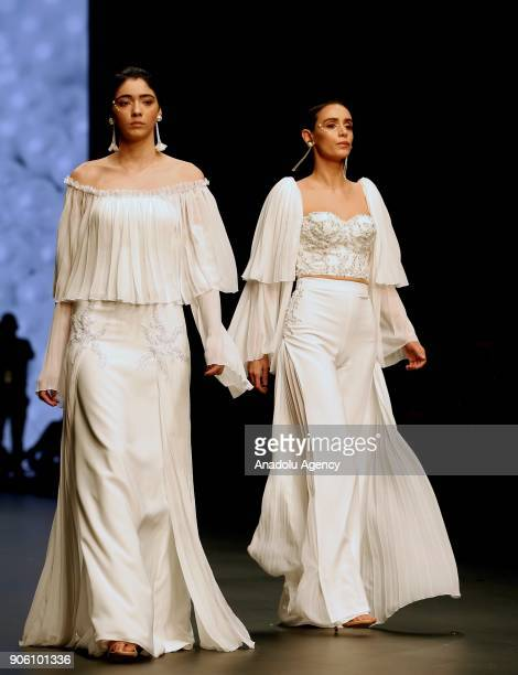 Models present the creation of Amor Garibovic who is last year's winner of Bridal Gown Design Contest at the 12th IF Wedding Dresses Suits and...