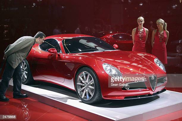 Models present the new Alfa Romeo 8C Competizione sports car at the Frankfurt Auto Show September 10, 2003 in Frankfurt, Germany. The show is open to...